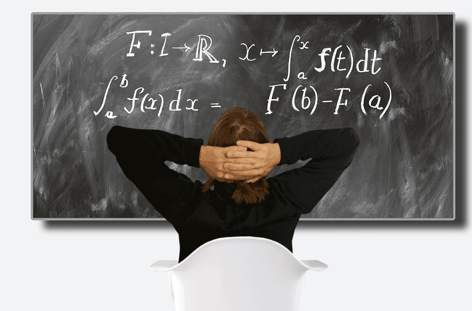 female student looking at a black board with calculus formula