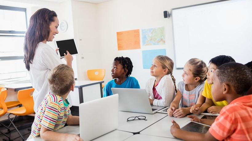 kids using laptops in class