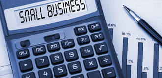 calculator with the words small business where the numbers should be