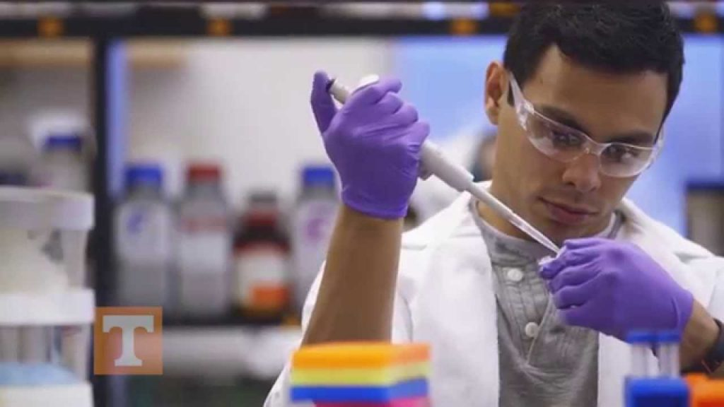 Man with pipet in lab