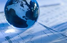 globe-multinational finance represented by a globe on top of chart on paper