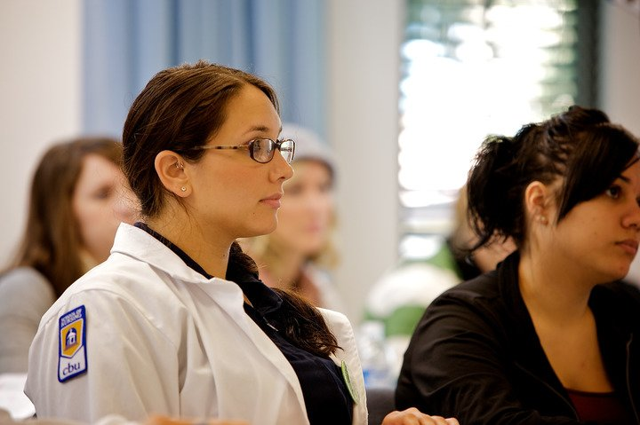 A Nursing Student listening intently to a lecture  at California Baptist University