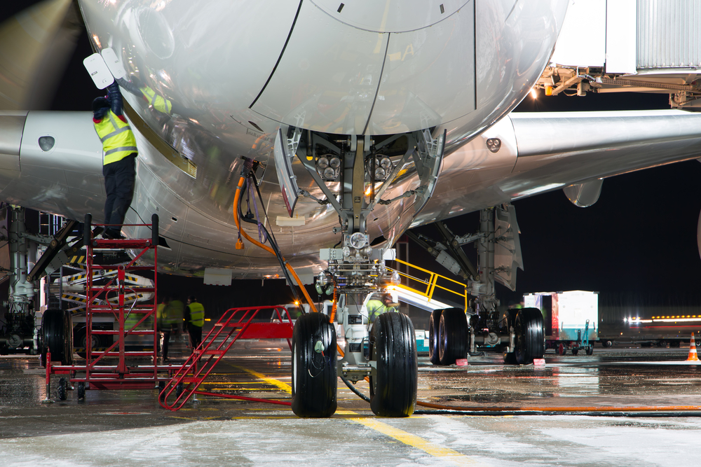 Picture of airplane being under maintenance