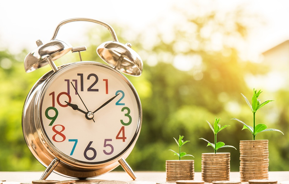stack of money growing with a small bud of plant on top of each stack and with a huge clock beside it