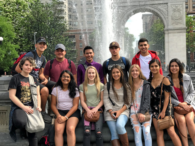 A group of students from Mendocino College posing for group picture in front of fountain