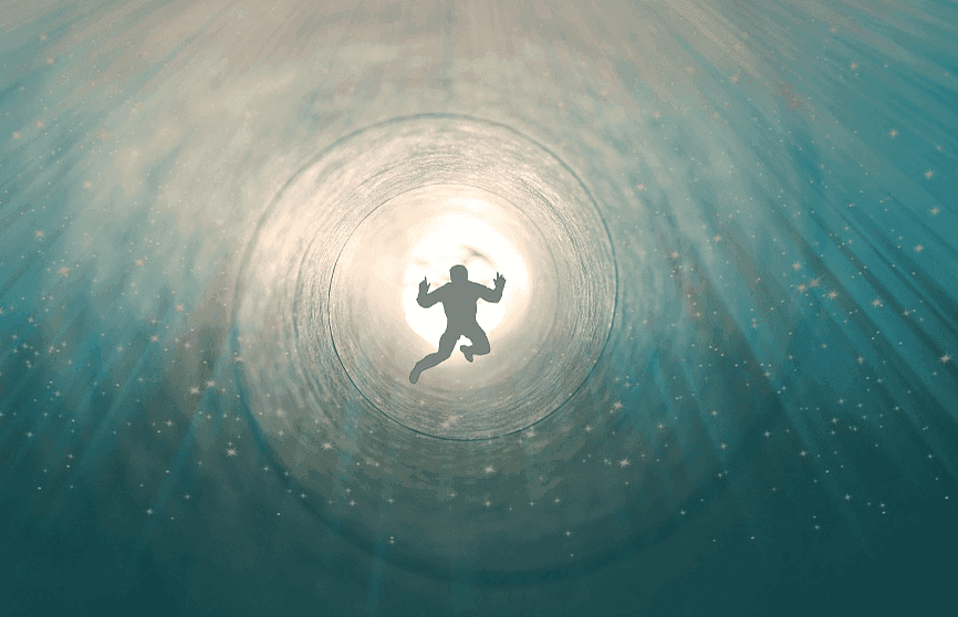 the idea of life after death, seen by a person swimming towards a bright light