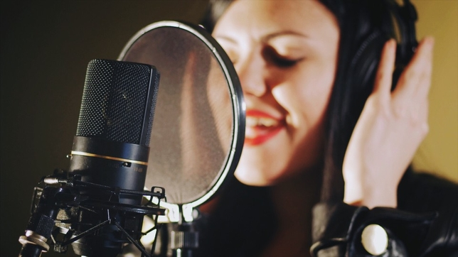 picture of someone singing in a studio