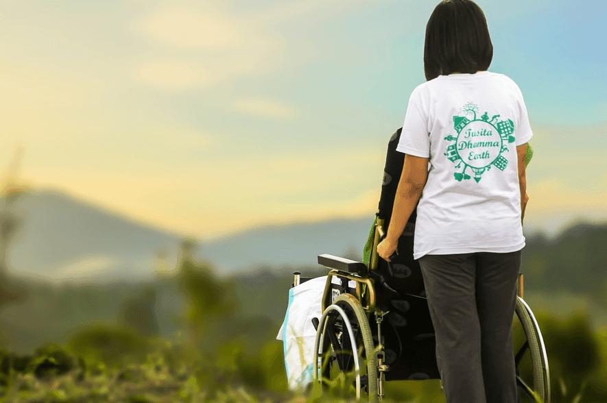 woman holding a wheel chair