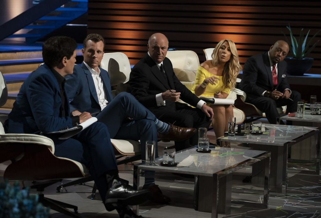 Shark Tank judges discuss a proposal.