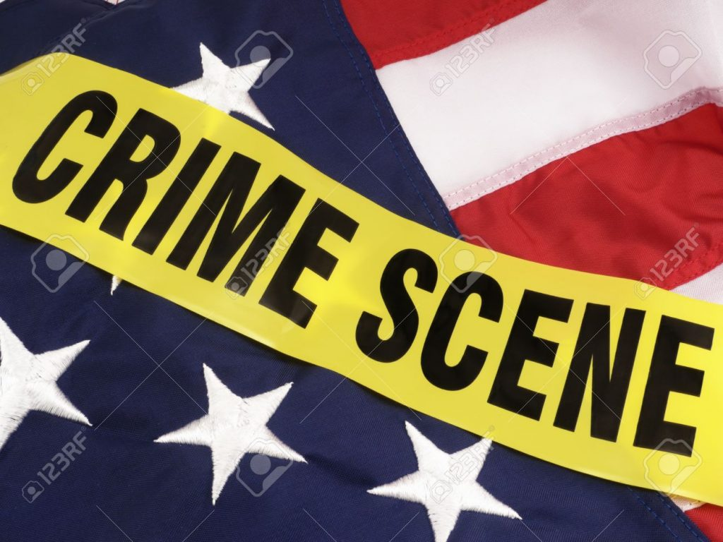 an image of the American flag with crime tape over it