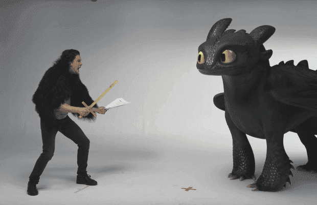 Picture of Kit Harington across from toothless, the dragon from How To Train Your Dragon movies