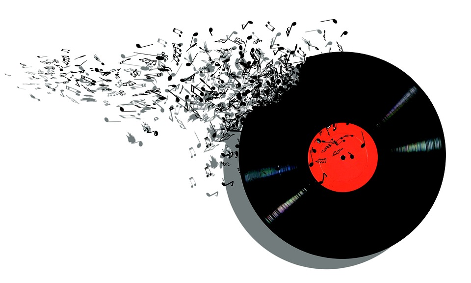 A record breaking with music notes spilling from the side