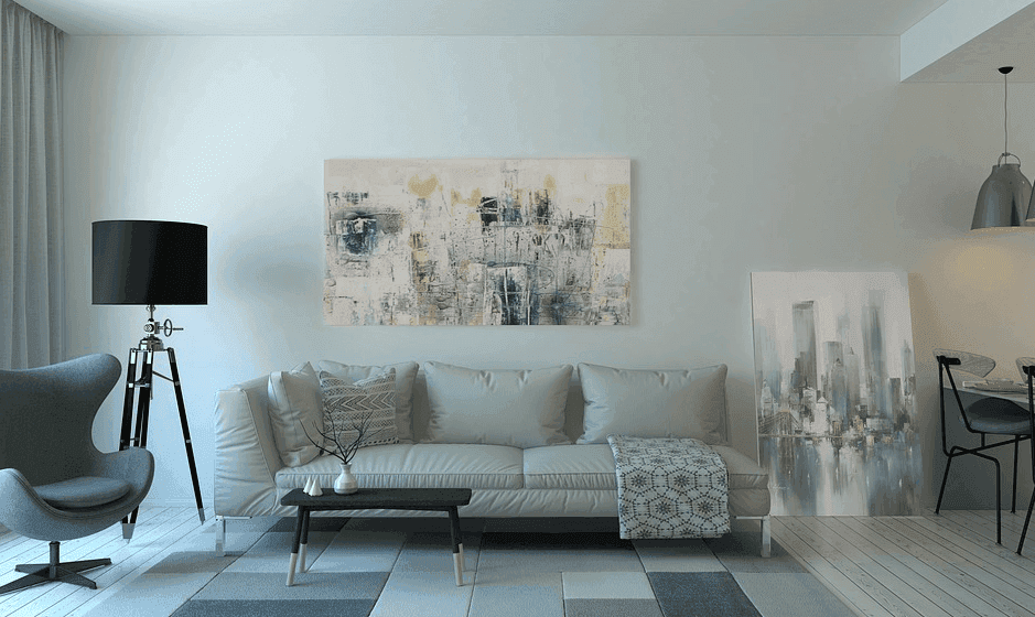 a beautiful interior design of a house with sofa and paintings