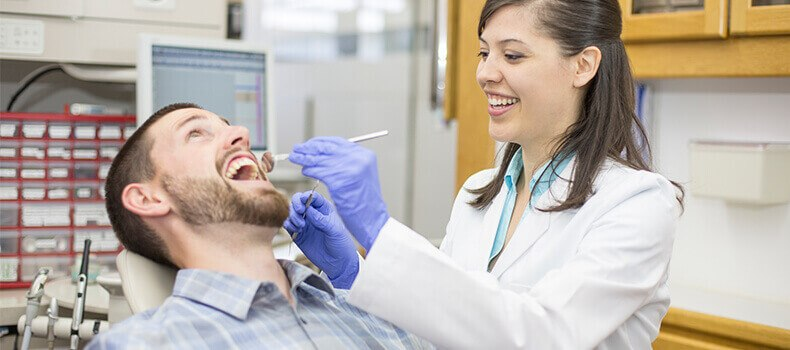 A dental hygienist and a patient