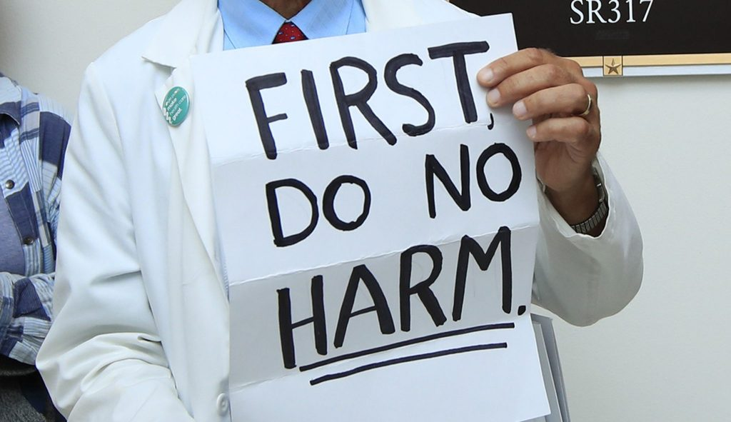 doctor holding a no harm sign