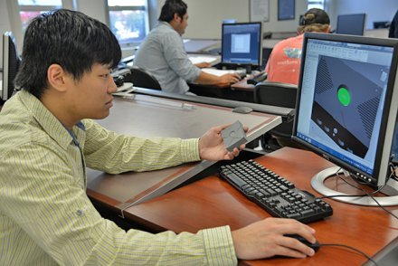 Computer technology student working on computer
