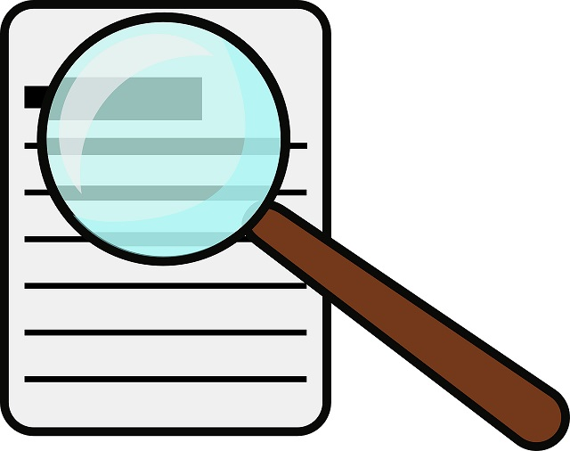 cartoon picture of a paper and a magnifying glass