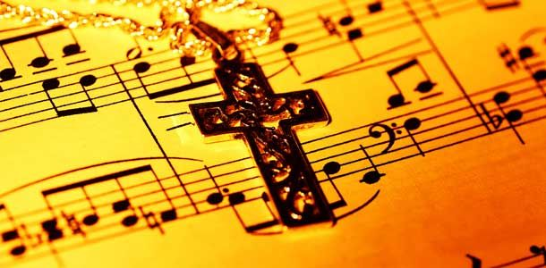 sheet music with a cross necklace