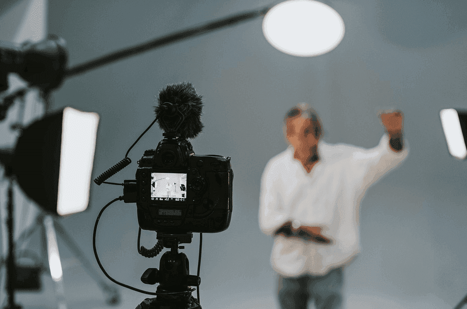 photo of various camera shooting at an actor with the camera in focus