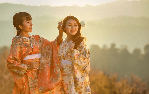2 women wearing ceremonial clothing