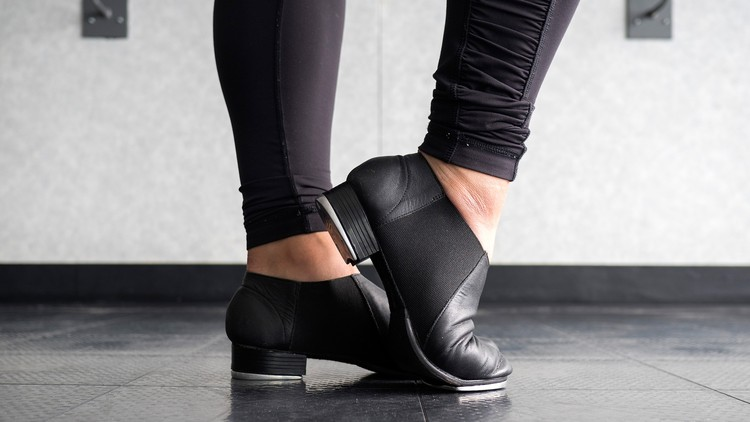A tap dancer's feet with tap dancing shoes