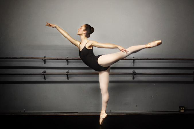 A female ballet dancer practicing