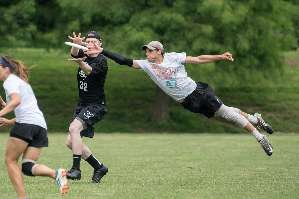 Picture of people playing ultimate frisbee.