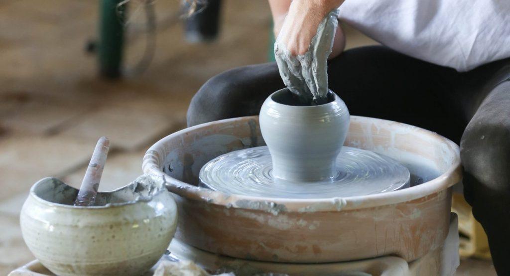 An artist creating a ceramic artefact
