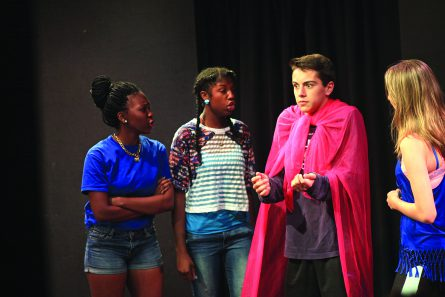 Picture of people acting at Saint Louis University Theater.