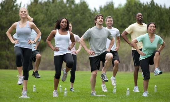 Image of a group of people exercising outside.