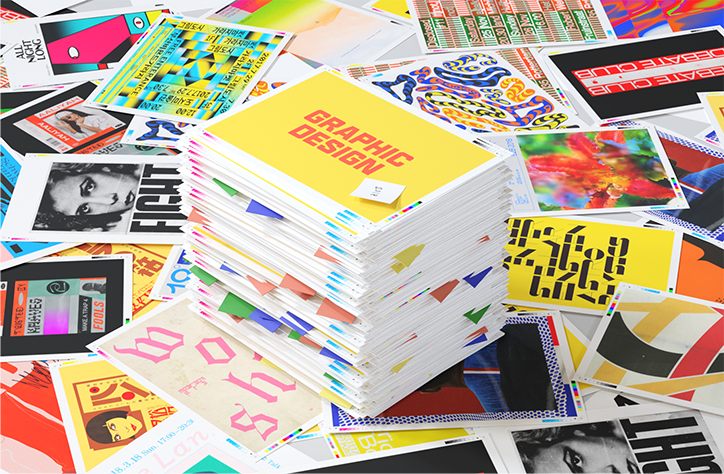 "a pile of papers and posters, atop a scattered flat pile of more posters and papers. Each paper has a different design on it, with the image at the top of the pile saying ""GRAPHIC DESIGN"" in all caps against a solid yellow background."