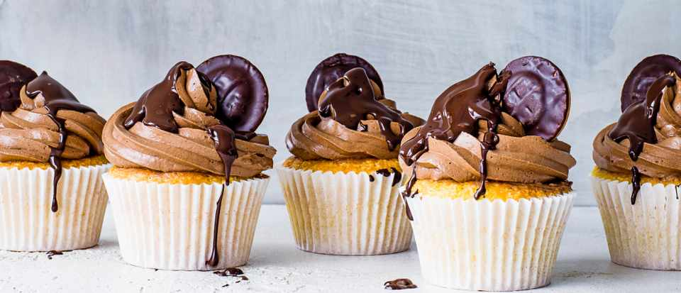 An image of cupcakes with chocolate cream