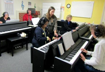 Students and instructors in a piano class