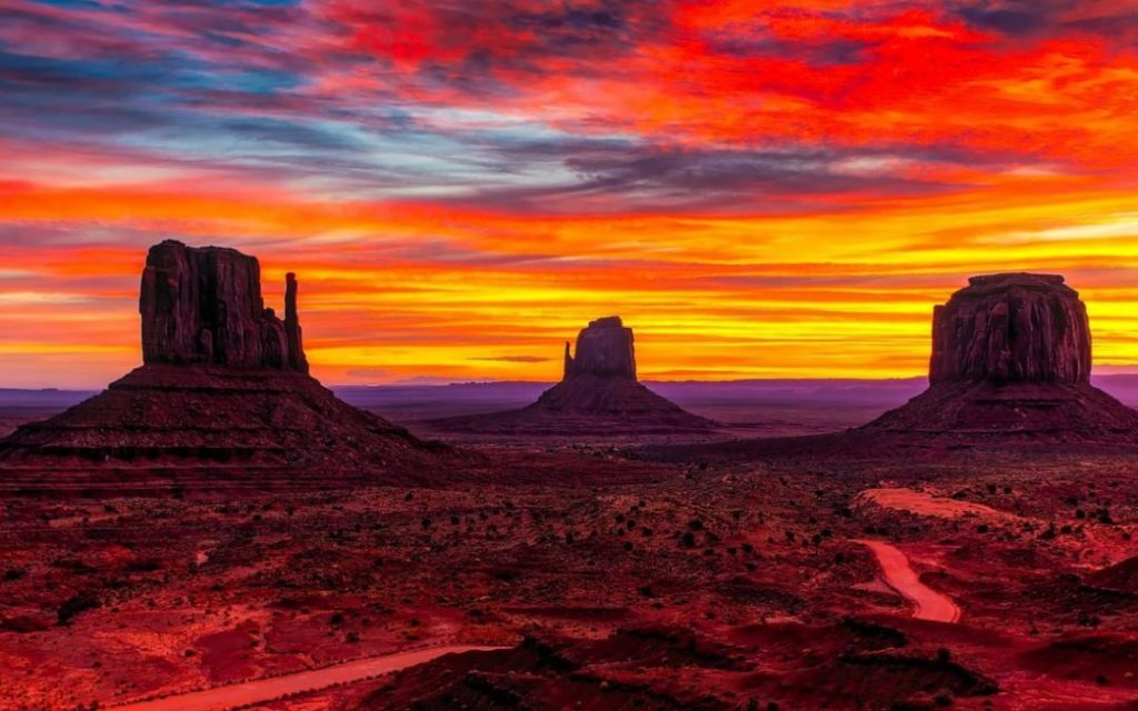 southwestern United States, vibrant red colors in sky, valley landscape