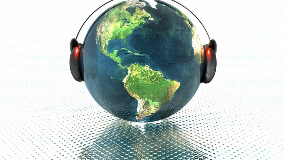 An image of the earth with headphones on it