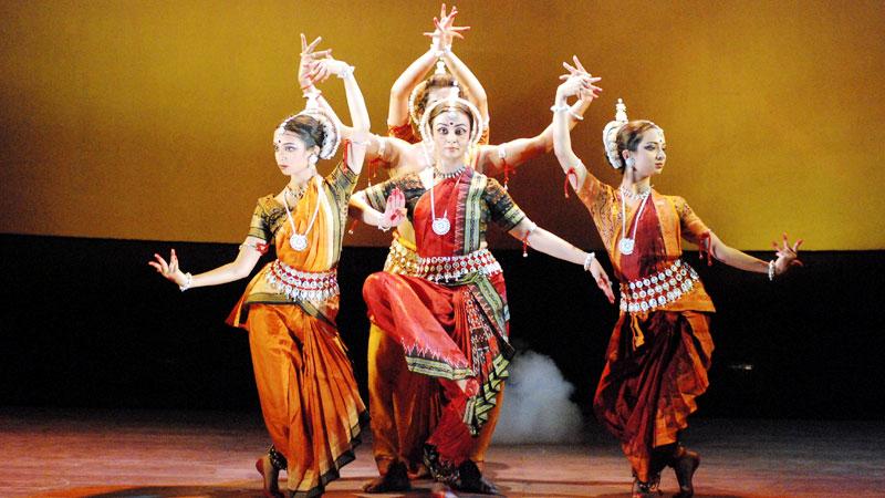 Three Women dancing an Indian traditional dance