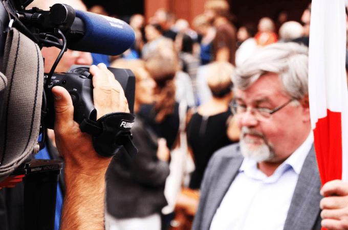 camera man shooting an old man