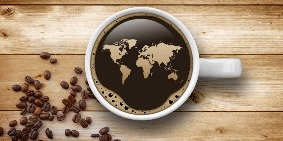Image of a map of the world floating in a cup of coffee.