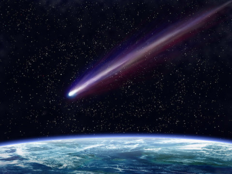 Comet flying over earth from space