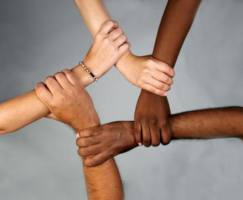 group of different ethnic background's hands in a star