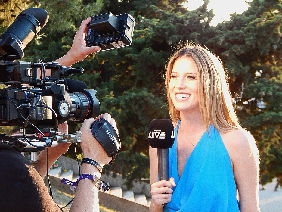 female reporter in front of a camera