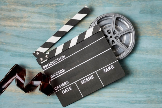 This is an image of a film roll and clapperboard.