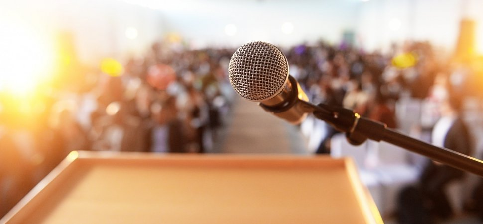 An image of a microphone on a stage