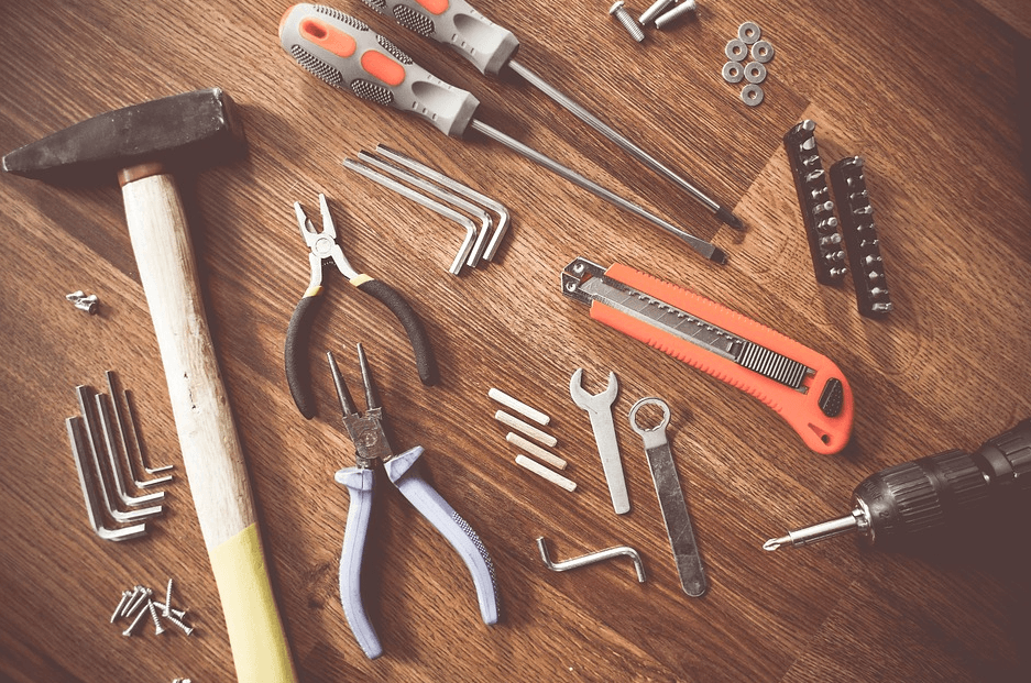 handyman tools laid out on the hardwood floor