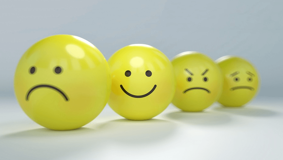 idea of human behavior as shown in balls, including different emotions like sad, happy, angry and worried