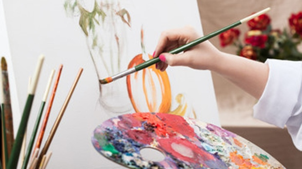 This is a picture of a person painting on a canvas.