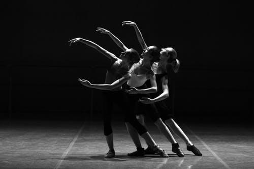 three women performing jazz dance