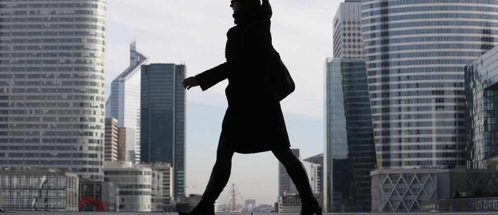 women in business suit with large city in background