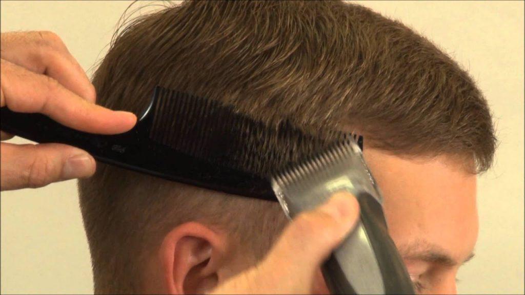 A barber cutting a person's hair