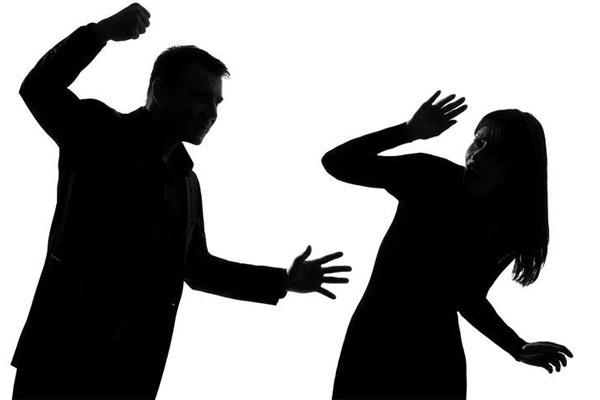 shadow of a man striking a woman